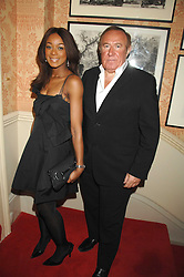 ANDREW NEIL and PHOEBE VELA at the engagement party of Vanessa Neumann and William Cash held at 16 Westbourne Terrace, London W2 on 15th April 2008.<br />