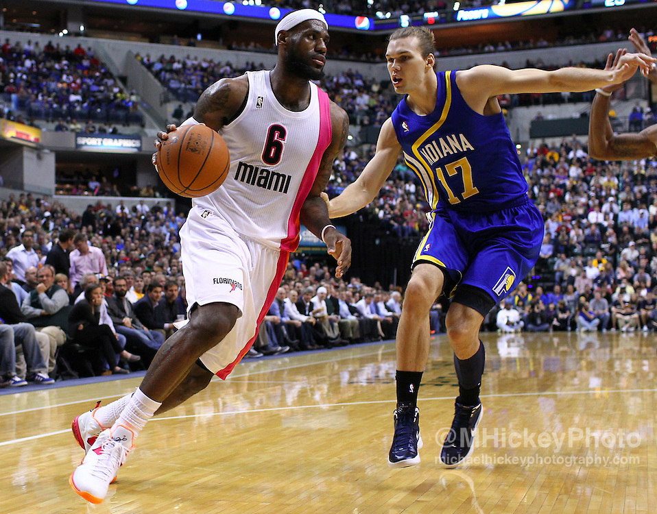 March 26, 2012; Indianapolis, IN, USA; Miami Heat small forward LeBron James (6) dribbles against Indiana Pacers center Louis Amundson (17) at Bankers Life Fieldhouse. Indiana defeated Miami 105-90. Mandatory credit: Michael Hickey-US PRESSWIRE