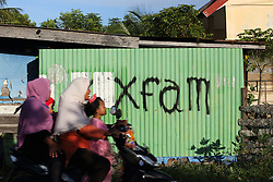Oxfam built latrine wall after the Indian Ocean Tsunami in Dec 2004 in Lampuuk village, District Aceh Besar, Aceh Province, Sumatra, Indonesia