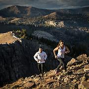Mountain athletes running high on a peak near Lake Tahoe, CA.