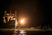 Fire fishing off Taiwan's north coast. The flame is placed to the port side or bow of the boat to attract the fish.