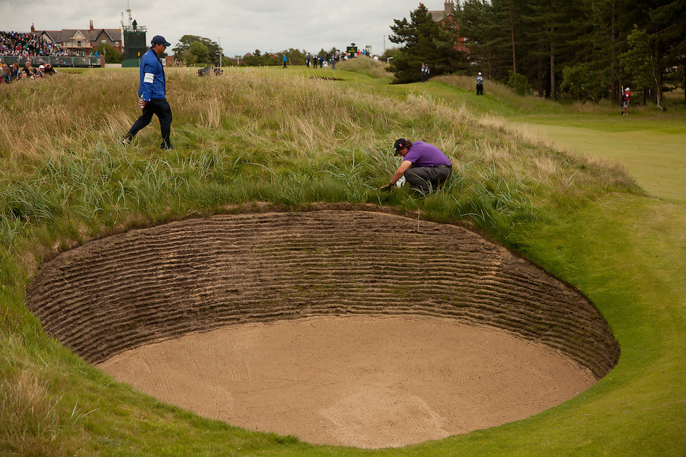 LYTHAM ST. ANNES, ENGLAND - JULY 19:  Phil Mickelson searches for his ball at the 8th hole after an errant bunker shot shot during the first round of the 141st Open Championship at Royal Lytham St Annes Golf Club in in Lytham St. Annes, England on July 19, 2012. (Photograph ©2012 Darren Carroll) *** Local Caption *** Phil Mickelson