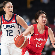 TOKYO, JAPAN August 8:  Naho Miyoshi #12 of Japan drives the basket watched by Diana Taurasi #12 of the United States during the Japan V USA basketball final for women at the Saitama Super Arena during the Tokyo 2020 Summer Olympic Games on August 8, 2021 in Tokyo, Japan. (Photo by Tim Clayton/Corbis via Getty Images)