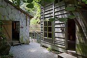 Reconstructed huts of the WW2-era Franja Partisan Hospital, on 20th June 2018, near Dolenji Novaki, Slovenia. From December 1943 until the end of the war as part of a broadly organized resistance movement against the Fascist and Nazi occupying forces, the hospital was set in a deep gorge in rural Slovenia where fighters were brought in from many areas to be treated in this secret location. 578 were treated here but the mortality rate were only 10% and the site was never discovered by German forces. Franja is in the UNESCO Tentative List of World Heritage sites.