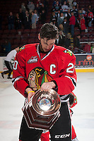 KELOWNA, CANADA - APRIL 25: Taylor Leier #20 of the Portland Winterhawks checks out the Western Conference Championship trophy on the ice at the against the Kelowna Rockets on April 25, 2014 during Game 5 of the third round of WHL Playoffs at Prospera Place in Kelowna, British Columbia, Canada. The Portland Winterhawks won 7 - 3 and took the Western Conference Championship for the fourth year in a row earning them a place in the WHL final.  (Photo by Marissa Baecker/Getty Images)  *** Local Caption *** Taylor Leier;