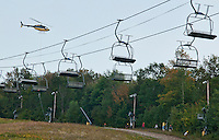 A helicopter is used to set the cable for Gunstock Mountain Resort's new Zip Line on Wednesday afternoon.