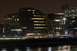 © Licensed to London News Pictures. 29/03/2014. London, UK. City Hall, seen with lights on, before turning off the lights in support of global Earth Hour 2014 at 8:30pm local time on 29th March 2014. Photo credit : Vickie Flores/LNP