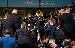 © Licensed to London News Pictures. 03/10/2017. Manchester, UK. British foreign secretary BORIS JOHNSON (left) surrounded by media as he arrives at the conference hall to deliver his keynote speech on day three of the Conservative Party Conference. The four day event is expected to focus heavily on Brexit, with the British prime minister hoping to dampen rumours of a leadership challenge. Photo credit: Ben Cawthra/LNP