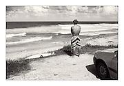 Surfer at Bathsheba Beach, Barbados.
