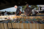 People searching for books at the second hand book stalls underneath Waterloo Bridge on the Southbank, London, United Kingdom. The South Bank is a significant arts and entertainment district, and home to an endless list of activities for Londoners, visitors and tourists alike. (photo by Mike Kemp/In Pictures via Getty Images)