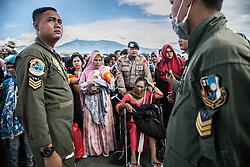 October 9, 2018 - Palu, Central Sulawesi, Indonesia - Indonesian military personnel prepare to evacuate local people board a Hercules plane at the Mutiara SIS Al-Jufrie Airport in Palu, Central Sulawesi. Nearly 2000 bodies have been recovered in Balaroa, Petobo and Sigi, two of Palu's hardest-hit neighborhoods. Officials warn that number will rise, with an estimated 5000 people still missing. (Credit Image: © Ivan Damanik/ZUMA Wire)