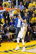 Golden State Warriors guard Stephen Curry (30) lays the ball into the basket against the Cleveland Cavaliers during Game 1 of the NBA Finals at Oracle Arena in Oakland, Calif., on May 31, 2018. (Stan Olszewski/Special to S.F. Examiner)