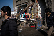 Migrants washing them selfs in a old bath tub installed by volunteers in Belgrade train station makeshift camp. March 17th, 2017, Belgrade, Serbia. Federico Scoppa