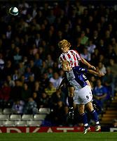 Photo: Steve Bond.<br />Birmingham City v Sunderland. The FA Barclays Premiership. 15/08/2007. Paul McShane (back) beats Mikael Forssell (front) in the air