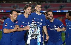 Left to right, Chelsea's Pedro, Marcos Alonso, Alvaro Morata and Cesc Fabregas celebrate with the FA Cup trophy