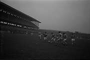 21/02/1965<br /> 02/21/1965<br /> 21 February 1965<br /> Munster v Ulster Railway Cup semi-final at Croke Park. The final score was Ulster 0-14 Munster 0-9.<br /> P. Griffin of Munster kicks the ball towards the Ulster goalmouth with Ulster full-back B. Brady in the foreground.