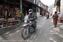 Grant Peterson passing through Modibeni on Day-7 of our Himalayan Heroes adventure riding from Tatopani to Pokhara, Nepal. Monday, November 12, 2018. Photography ©2018 Michael Lichter.
