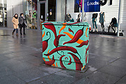 Brightly painted with chili design, a telecoms junction box in Southwark in South London. These boxes have started to appear all over the borough as unique street art.