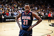 SHOT 1/21/12 7:07:53 PM - Arizona's Kyle Fogg #21reacts after losing a close game to Colorado during their PAC 12 regular season men's basketball game at the Coors Events Center in Boulder, Co. Colorado won the game 64-63..(Photo by Marc Piscotty / © 2012)