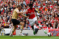 Photo: Richard Lane/Richard Lane Photography. Arsenal v Juventus. Emirates Cup. 02/08/2008. Arsenal's Emmanuel Adebayor is challenged by Juventus'  Olof Mellberg.