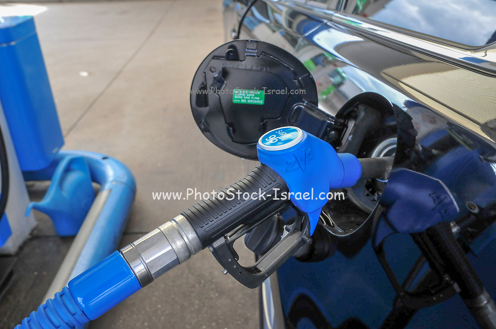 Petrol Station car is refuelled with unleaded super 95 petrol. Photographed in Germany