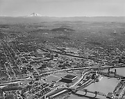 """Ackroyd 16605-1. """"City of Portland. Aerials. February 20, 1970""""  (see color C2788 Memorial Colesium, Willamette River, looking south-east.)"""