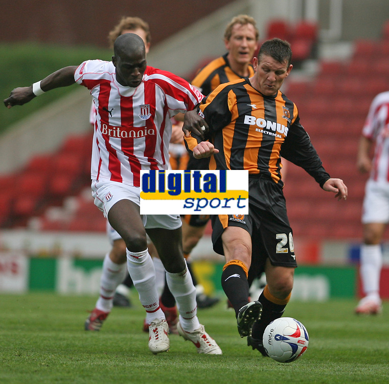 Photo: Pete Lorence.<br />Stoke City v Hull City. Coca Cola Championship. 21/04/2007.<br />Mamady Sidibe and Dean Windass battle for the ball.