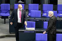 11 FEB 2021, BERLIN/GERMANY:<br /> Peter Altmeier (L), CDU, Bundeswirtschaftsminister, und Horst Seehofer (R), CSU, Bundesinnenminister, im Gespraech, vor Beginn der Regierungserklaerung der Bundeskanzlerin zur Bewaeltigung der Corvid-19-Pandemie, Plenum, Reichstagsgebaeude, Deutscher Bundestag<br /> IMAGE: 20210211-01-006<br /> KEYWORDS: Corona, Gespräch, Mundschutz, Maske