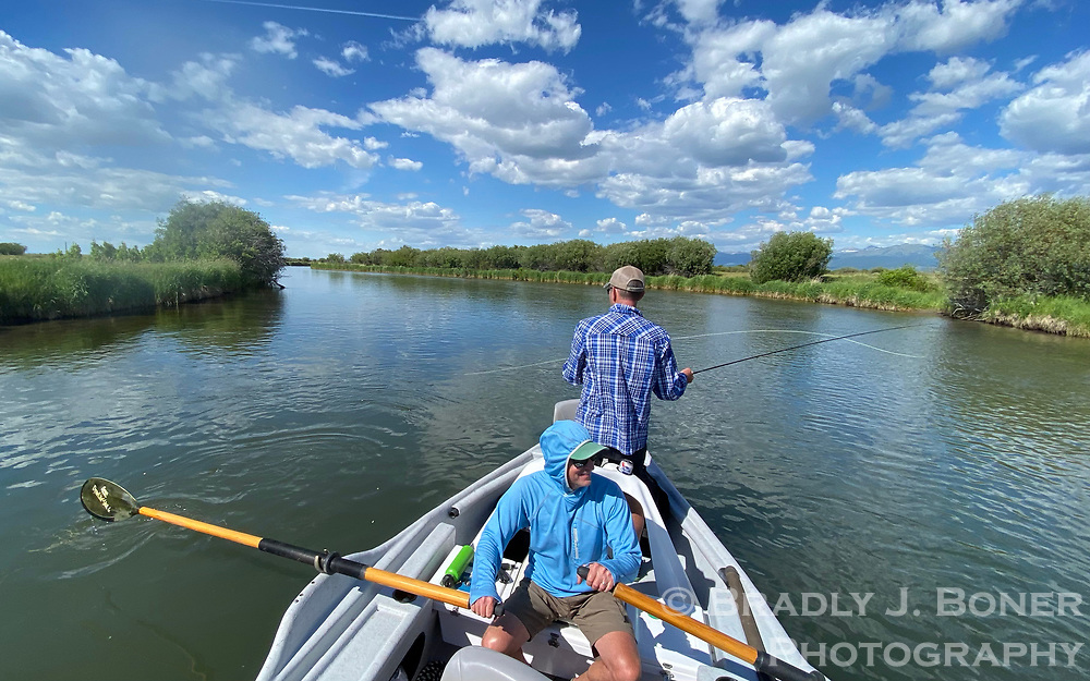 Cory Hatch and Dan Bierman fish the Teton River for cutthroat trout Sunday in Teton Valley, Idaho. Temperatures in the mid-80s are forecast for the foreseable future with a chance of rain over the weekend.