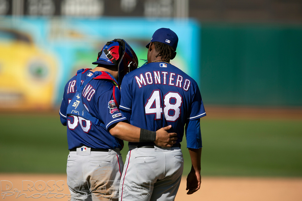 Texas Rangers catcher Jose Trevino (56) and pitcher Rafael Montero (48) confer during the eighth inning of a baseball game against the Oakland Athletics, Sunday, Sept. 22, 2019, in Oakland, Calif. (AP Photo/D. Ross Cameron)