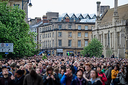 © Licensed to London News Pictures. 01/05/2017. Oxford, UK. Thousands of Oxford University students and members of the public fill the streets surrounding Magdalen Bridge in Oxford to celebrate May Day in the early hours of the morning. Students were again prevented from jumping from the bridge in tot he water, which has historically been a tradition, due to injuries at a previous years event . Photo credit: Ben Cawthra/LNP