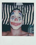 Puma dresses up as the Joker for Halloween night.
