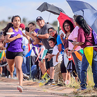 Miyamura Patriot Kila Vicente nears the finish to win the girls varsity race during the Rehoboth Invitational cross country meet in Rehoboth Friday. Vicente finished with a time of 22:24.