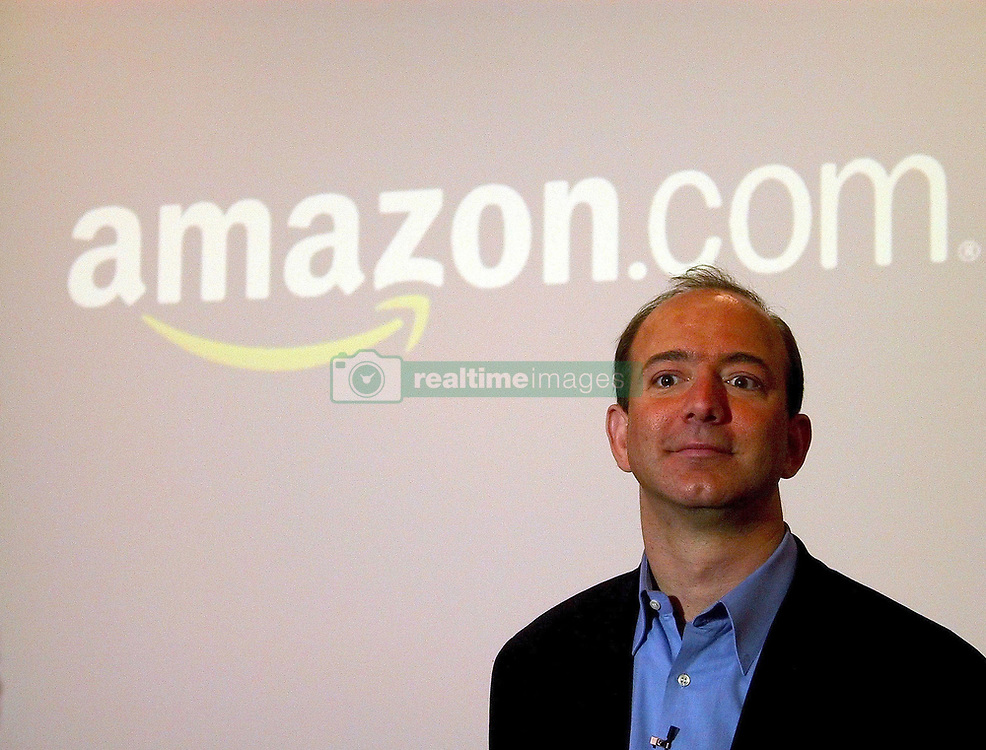 June 16, 2017 - FILE PHOTO - Amazon has acquired Whole Foods, a move that marks the e-commerce giant's official entry into the world of physical stores as well as groceries. It's Amazon's biggest acquisition ever, paying $13.7 billion in cash for the grocery chain, which now operates some 465 stores across the U.S. Amazon has grown into a retail behemoth and has has been tip-toeing into bookstores and experimental convenience stores. Those efforts led to speculation that Amazon eventually would make a major acquisition of a chain, rather than slowly build out its own stores. That acquisition ended up being Whole Foods. Pictured: Jun 06, 2008 - San Francisco, California, USA - Service at Amazon.com Inc.'s Web site was unavailable for a period of time on Friday. Amazon's homepage returned the message ''Http/1.1 Service Unavailable'' against a blank white screen. No reason for the service interruption was listed, and company representatives were not available for immediate comment. Shares of Amazon were down 2.7 percent to 2.25 in early afternoon trading. PICTURED: Date Unknown - Fernley, Nevada, USA - Founder and CEO of Amazon.com, JEFF BEZOS gears up for the holiday season at Amazon's distribution center (Credit Image: Mark Richards/ZUMAPRESS.com)