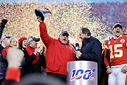 Kansas City Chiefs owners, Norma Hunt, left, her son Clark Hunt, second from left, and quarterback Patrick Mahomes, right, look on as Kansas City Chiefs head coach Andy Reid, center, holds up the Lamer Hunt Trophy as they celebrate winning the NFL AFC Championship football game against the Tennessee Titans Sunday, Jan. 19, 2020, in Kansas City, MO. The Chiefs won 35-24 to advance to Super Bowl 54. (AP Photo/Colin E. Braley) Colin Eric Braley Photography