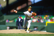 CHICAGO - 1988: Dennis Eckersley of the Oakland Athletics pitches during an MLB game at the Comiskey Park in Chicago, Illinois.  Eckersley pitched for the Athletics from 1987-1995. (Photo by Ron Vesely)