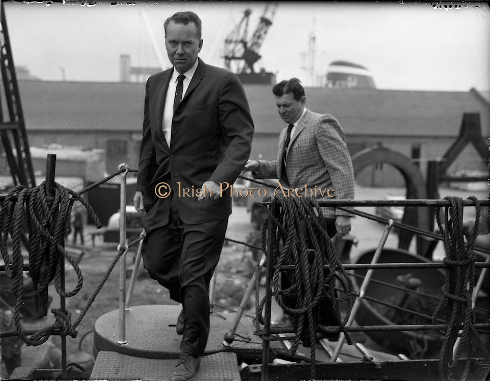 31/07/1962<br /> 07/31/1962<br /> 31 July 1962<br /> Oil drilling equipment arrives in Dublin. Equipment to be used in the drilling of the 1st exploratory oil well at Rathmolyon, Trim, Co. Meath, arrived in Dublin by ship from Texas. Picture shows Mr David T. Kiester, Operations Manager, Ambassador Irish Oil Co. and Mr Calvin Galyen, Drilling Co., inspecting some of the rig.