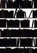 Bookcase shelves filled with books in silhouette