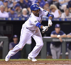 August 30, 2017 - Kansas City, MO, USA - The Kansas City Royals' Alcides Escobar lays down a bunt single in the third inning against the Tampa Bay Rays at Kauffman Stadium in Kansas City, Mo., on Wednesday, Aug. 30, 2017. (Credit Image: © John Sleezer/TNS via ZUMA Wire)
