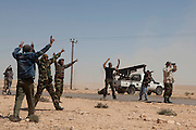 Mcc0030300 . Daily Telegraph..Rebel fighters celebrate after firing katushya rockets towards Libyan government forces on the frontline near the oil town of Brega..Brega 5 April 2011