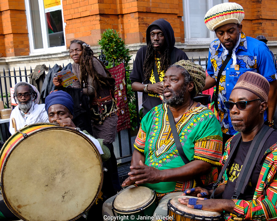 Men  drumming.Groundation Reggae music at annual Reparations Revolution event on Afrikan Emancipation Day in Windrush Square Brixton 2021.
