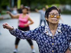 June 5, 2017 - Bangkok, Bangkok, Thailand - A woman participates in an adult aerobics class in Lumpini Park in Bangkok. Thai health officials estimate that about 17% of Thais are 60 years old and older, putting Thailand right on the cusp of being an aging society. Many public health centers and government offices in Thailand offer free exercise classes for Thai seniors in an effort to keep older Thais healthy and mobile. (Credit Image: © Jack Kurtz via ZUMA Wire)