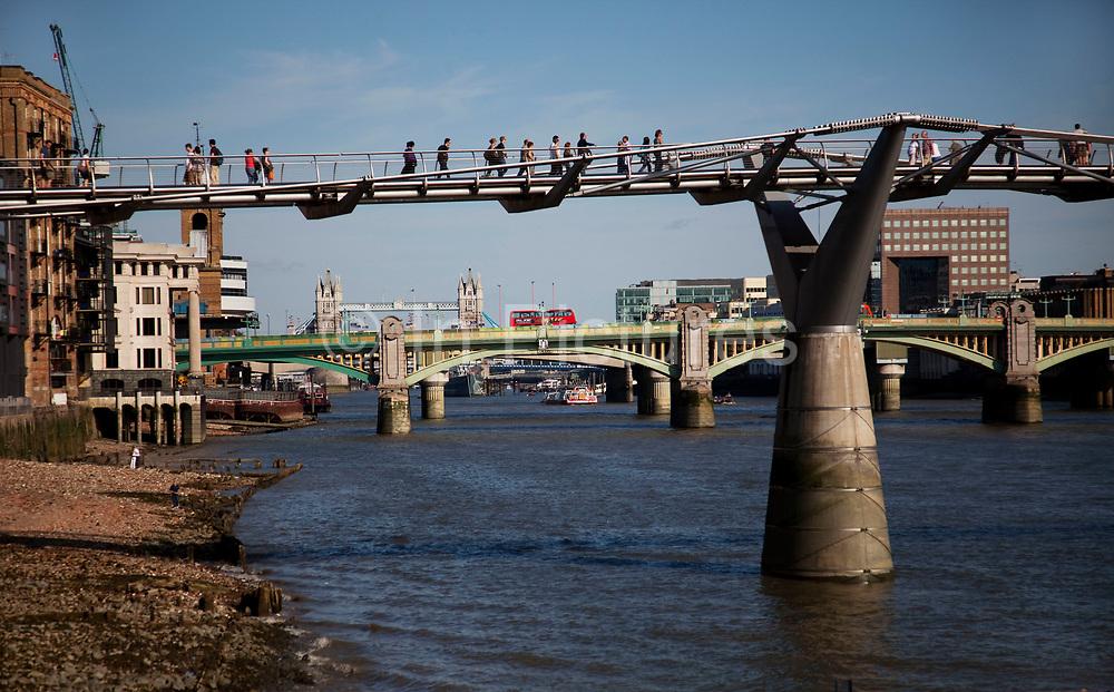 Scene of the River Thames, London. Running through the heart of the city. EPople crossing Millennium bridge