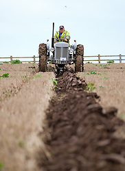 © Licensed to London News Pictures. <br /> 30/11/2014. <br /> <br /> Boulby, United Kingdom<br /> <br /> A competitor ploughs during a ploughing match that takes place each year on fields next to the picturesque Yorkshire coastline near Staithes. Farmers attend each year to demonstrate their ploughing skills and to help raise money for charity with proceeds from this year going to Charlie Brown Cancer Care in Newcastle.<br /> <br /> <br /> Photo credit : Ian Forsyth/LNP