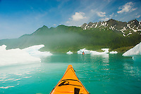 Kayaking through clearing fog at Bear Lake, Kenai Fjords National Park, Alaska