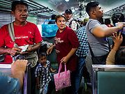 02 JANUARY 2019 - BANGKOK, THAILAND:      People on a train bound for Trang, in southern Thailand, look for their seats before the train left Hua Lamphong Train Station in Bangkok. The train and bus stations in Bangkok were crowded Wednesday with people going home after the long New Year's weekend.      PHOTO BY JACK KURTZ