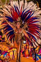 Samba dancer on a float in the Carnaval parade of Grande Rio samba school in the Sambadrome, Rio de Janeiro, Brazil.
