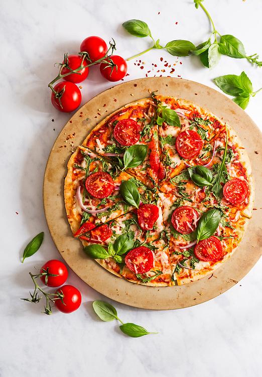 Overhead view of veggie pizza