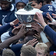 NEW HAVEN, CONNECTICUT - NOVEMBER 18: The Yale team with the trophy during the Yale V Harvard, Ivy League Football match at the Yale Bowl. Yale won the game 24-3 to win their first outright league title since 1980. The game was the 134th meeting between Harvard and Yale, a historic rivalry that dates back to 1875. New Haven, Connecticut. 18th November 2017. (Photo by Tim Clayton/Corbis via Getty Images)
