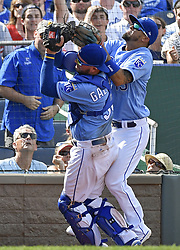August 20, 2017 - Kansas City, MO, USA - Kansas City Royals third baseman Cheslor Cuthbert runs into catcher Cam Gallagher as Gallagher makes the foul ball catch for an out on Cleveland Indians' Carlos Santana to end the top of the eighth inning on Sunday, Aug. 20, 2017 at Kauffman Stadium in Kansas City, Mo. (Credit Image: © John Sleezer/TNS via ZUMA Wire)